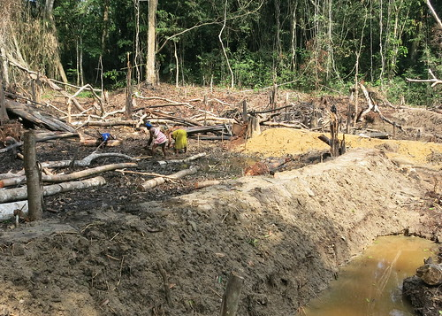 Women working to dig fishpond