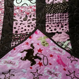 I waited all day to post this for WIP Wednesday,  only to realize it's Tuesday. The Cowgirl quilt is finished!