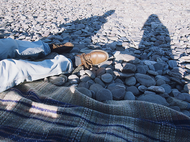 Mansands, Kingswear Devon. Picnic rug on the pebbles.