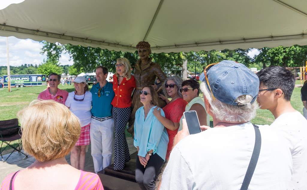 Carolyn Palmer (in the red top and polka dot slacks) Created the New I Love Lucy Statue Which is in Lucille Ball Memorial Park, Celoron, N.Y., Aug. 6, 2016.