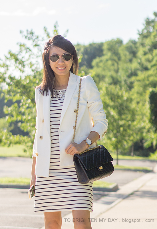 white blazer, jeweled shift striped dress, oversized watch, black shoulder bag
